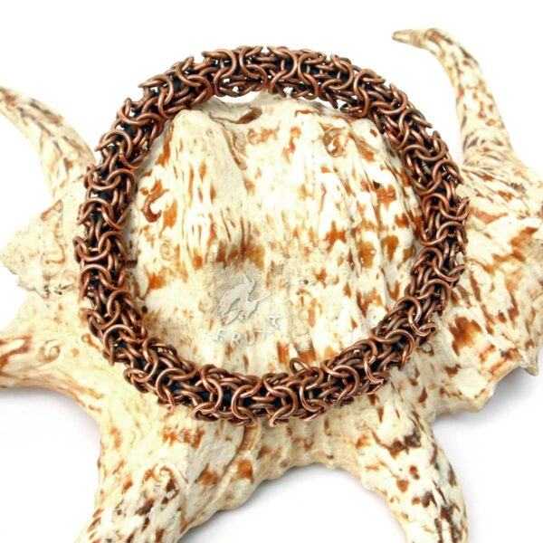 Masywna bransoletka typu bangle pleciona z miedzi